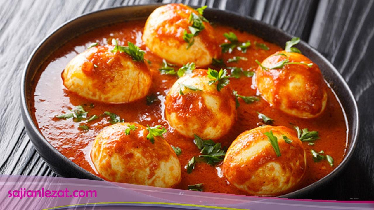 Resep Gulai Telur - egg curry bahan 6 butir telur, rebus, kupas 4 sendok makan minyak goreng 400 ml santan kental 2 lembar daun jeruk, buang tulangnya 1 lembar daun kunyit 2 batang serai, memarkan  cara masak  Panaskan minyak goreng, tumis bumbu halus hingga harum. Masukkan daun jeruk, daun kunyit, dan serai, aduk-aduk sampai layu. Masukkan telur, aduk hingga rata, tuang santan, masak hingga bumbu meresap dan kuah kental serta berminyak, angkat, hidangkan.